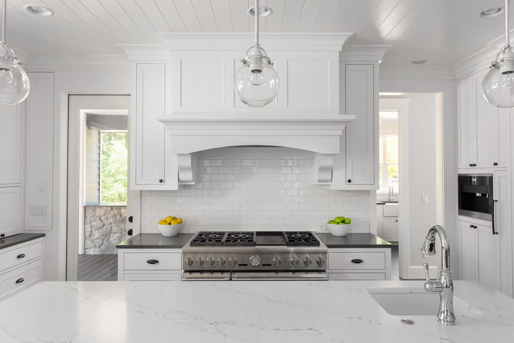 Traditional-Styled Kitchen with Concealed, Disappearing Range Hoods