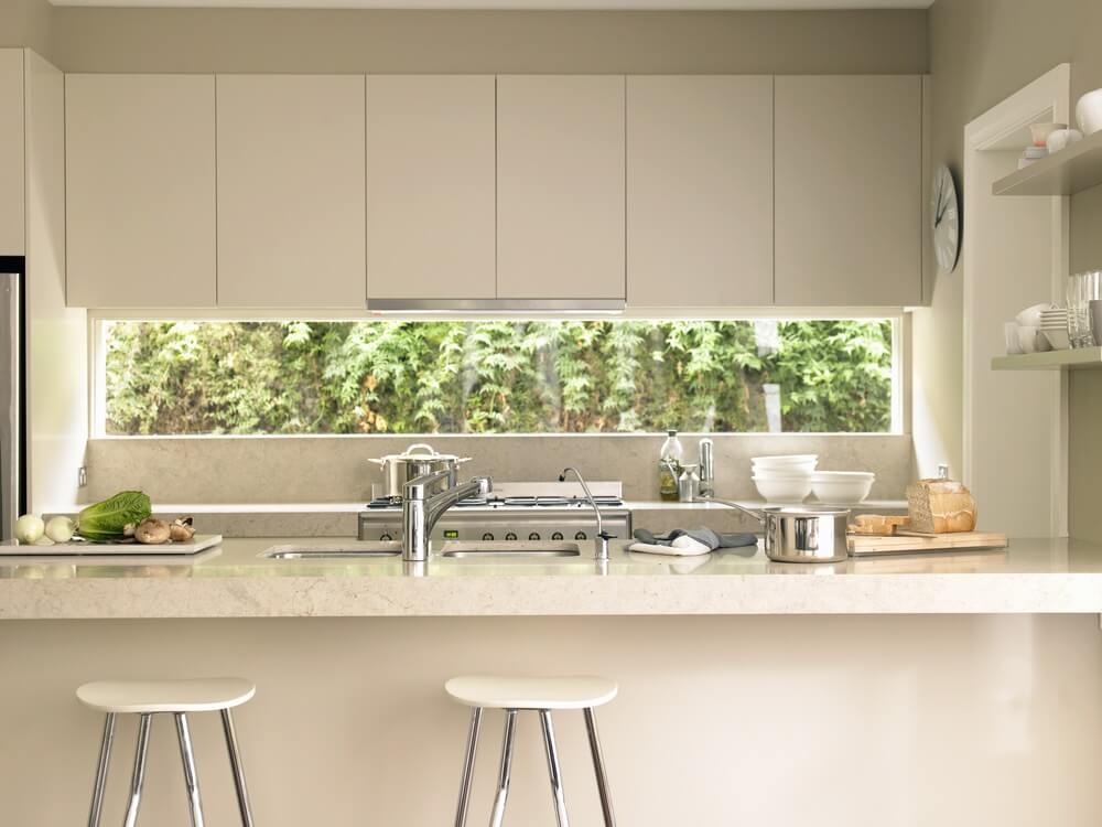 Small Galley kitchen with Disappearing Range Hoods