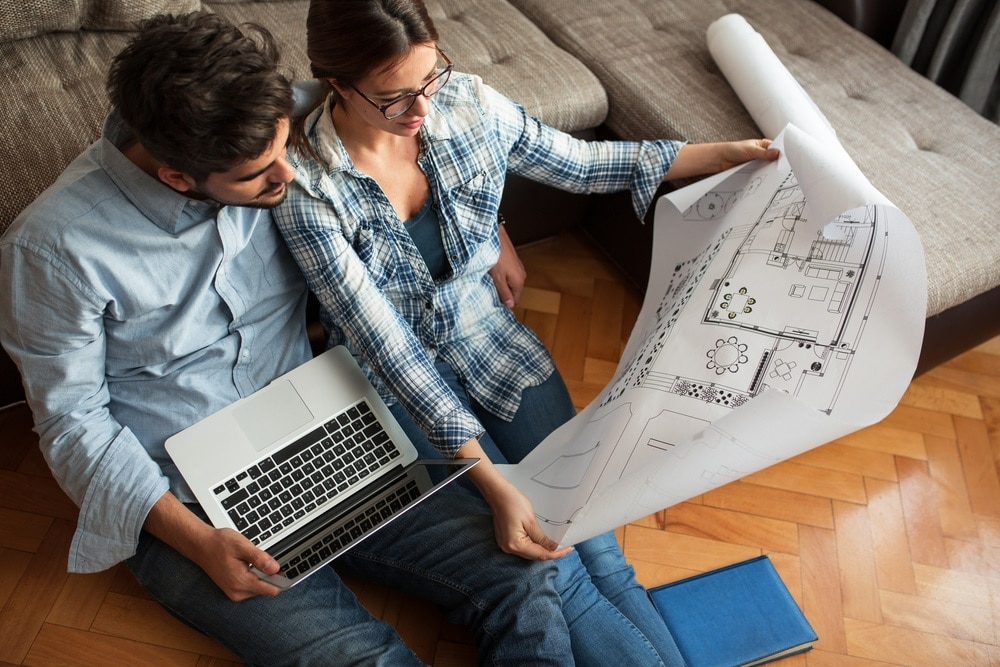 Couple looking at floorplan. How to Design Your Home
