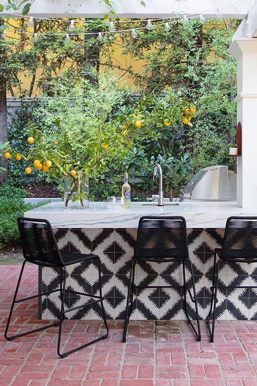 outdoor kitchen with plants fun tiles patterned