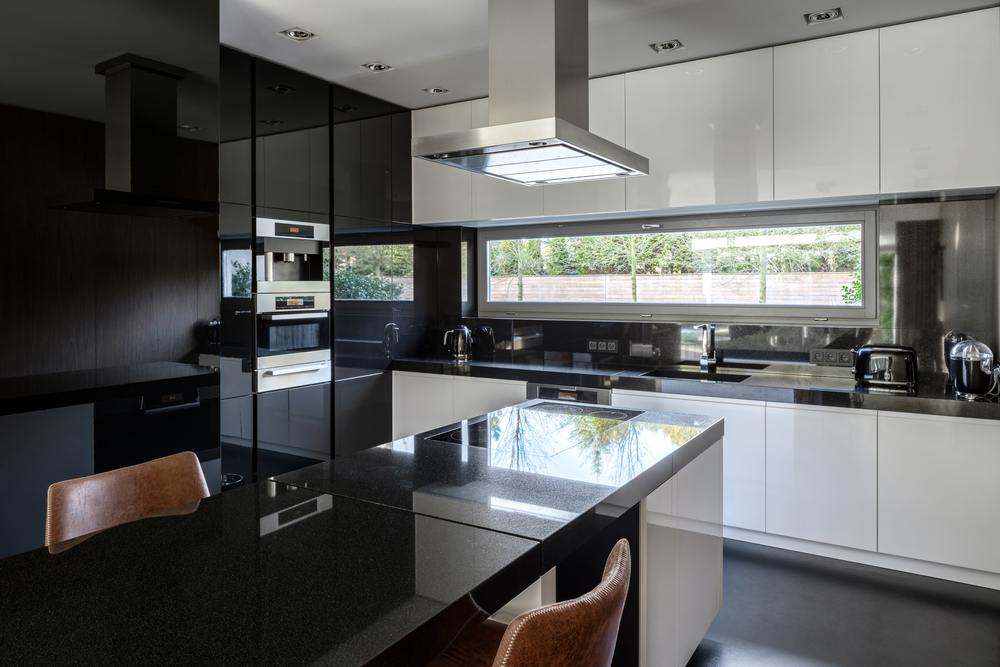 Modern black and white kitchen with kitchen island