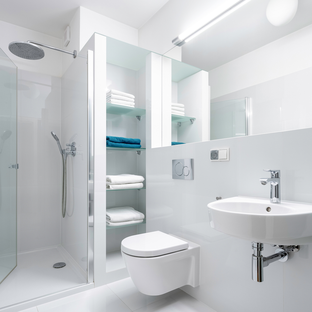 white bathroom glass towel storage
