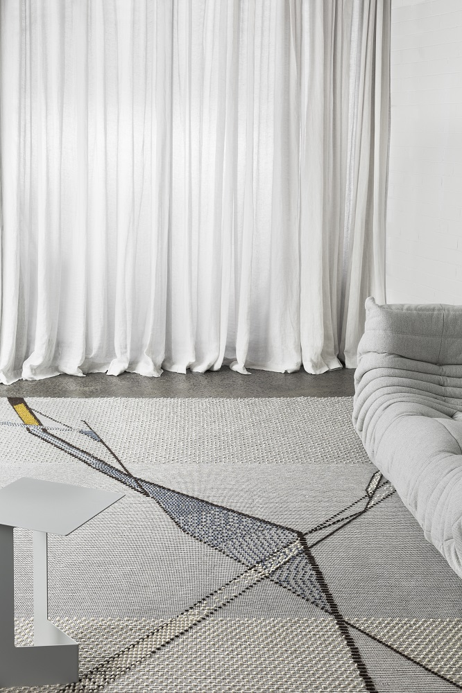 """""""Architect Paulina Herrera expressed her love for geological textures in the Fessura rug because it resembles a large crack running through a boulder."""""""