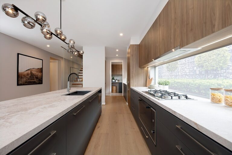 """""""In this lovely kitchen space, cabinet makers used Notaio Walnut Woodmatt for the cupboards and Cinder Venette for the lower cabinets."""""""