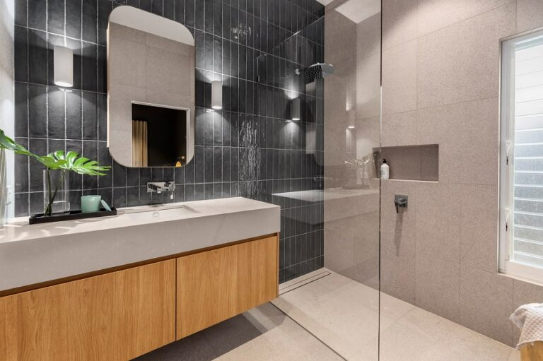 """""""We adore the handmade aesthetics of the Amano Marina ceramic tile used in this bathroom's wall."""""""