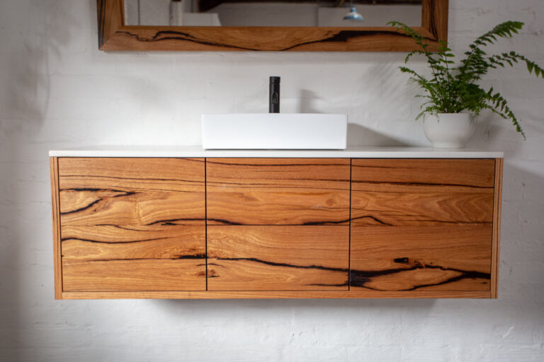 """""""For the environmentally conscious developers and renovators, opt for the Red Hill floating bathroom vanity because it's made from recycled timber and stone top."""""""