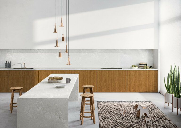 """""""The Cloudburst Concrete™ island bench and splashback paired with white and timber accents look undoubtedly beautiful."""""""