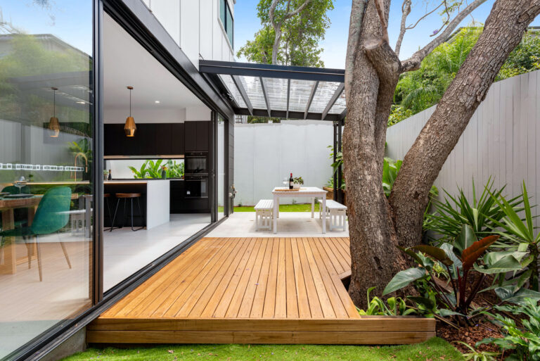 """""""This is an impressive patio design with a combination of decking, paving, and lawn."""""""