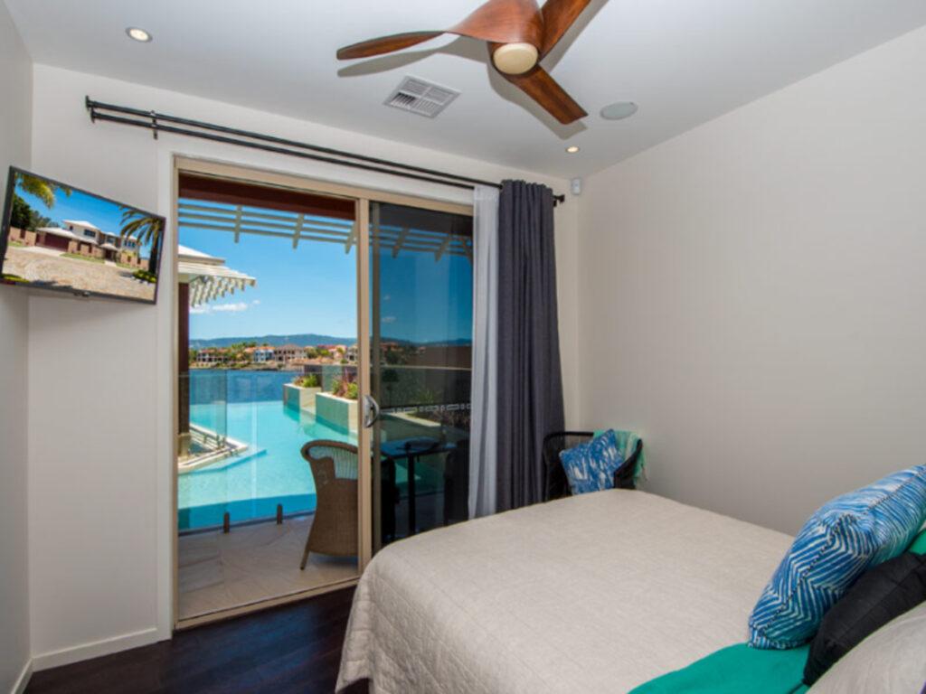 bedroom overlooking an infinity-edge pool