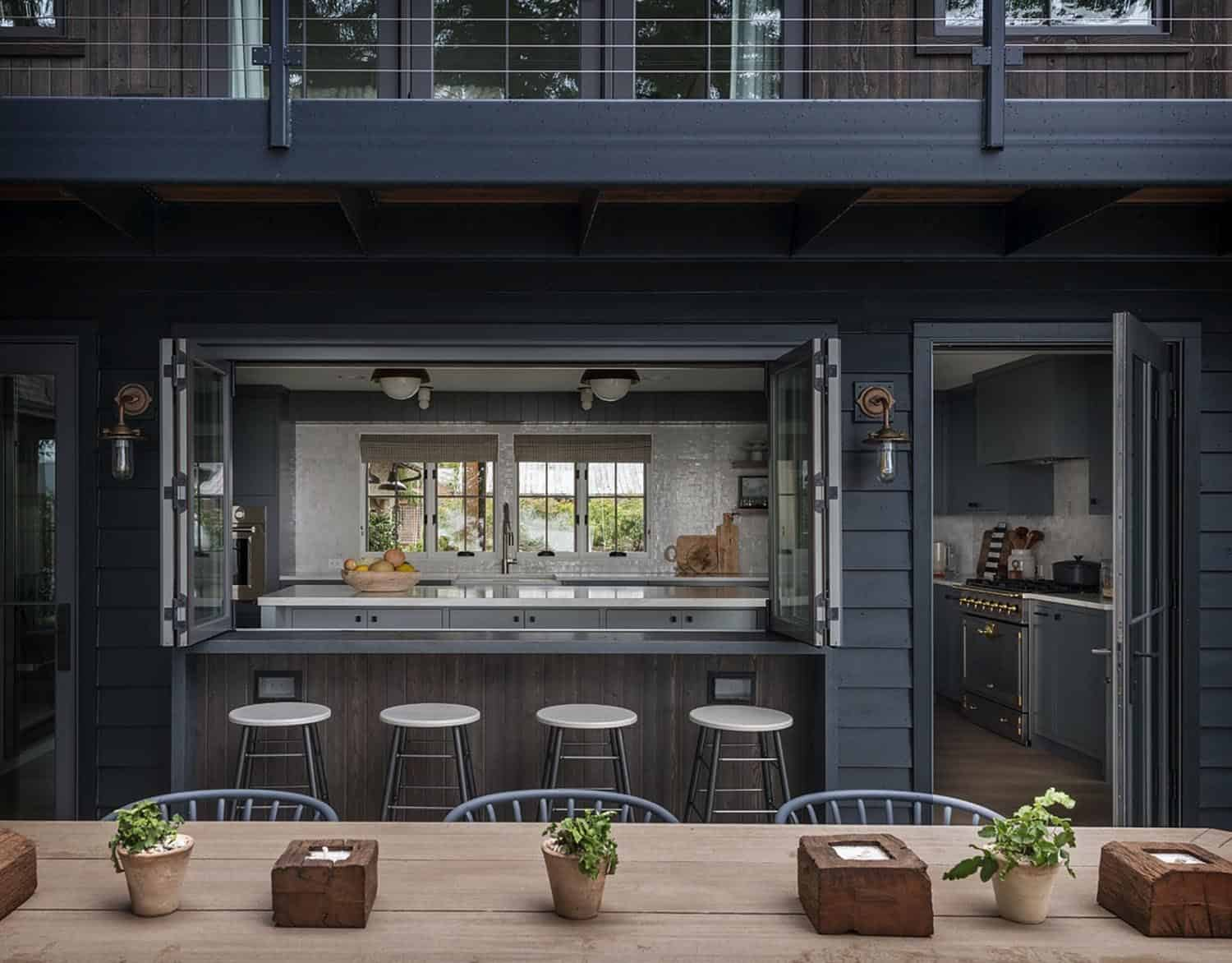 industrial-style indoor-outdoor kitchen with bar