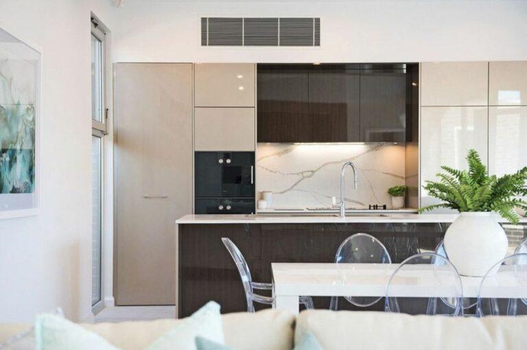 superdraft-open-galley-kitchen-with-seamless-beige-cabinets-3-01617699234
