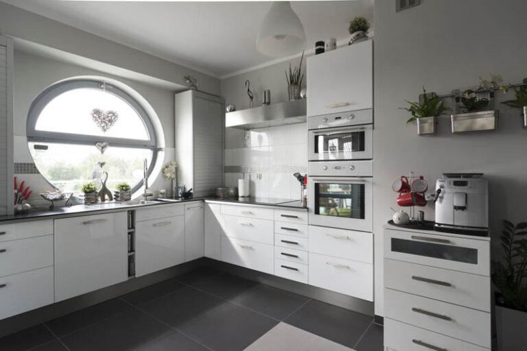 superdraft_kitchen-round-window-elevates-the-look-of-this-modern-white-kitchen-11599457938