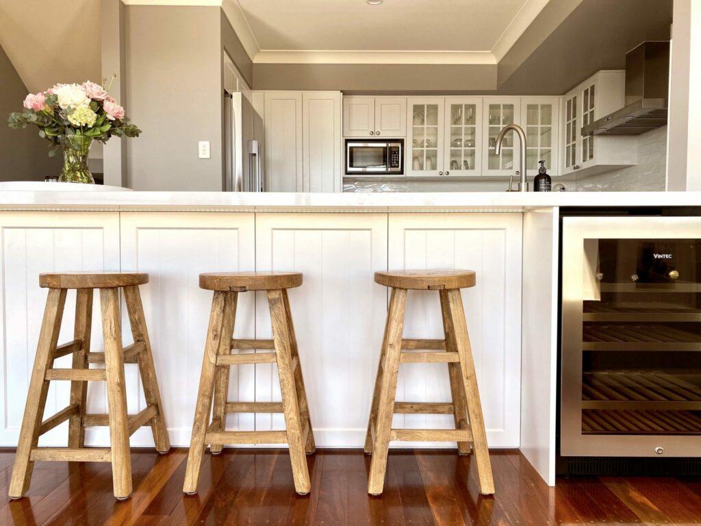 farmhouse-like kitchen with wood barstools