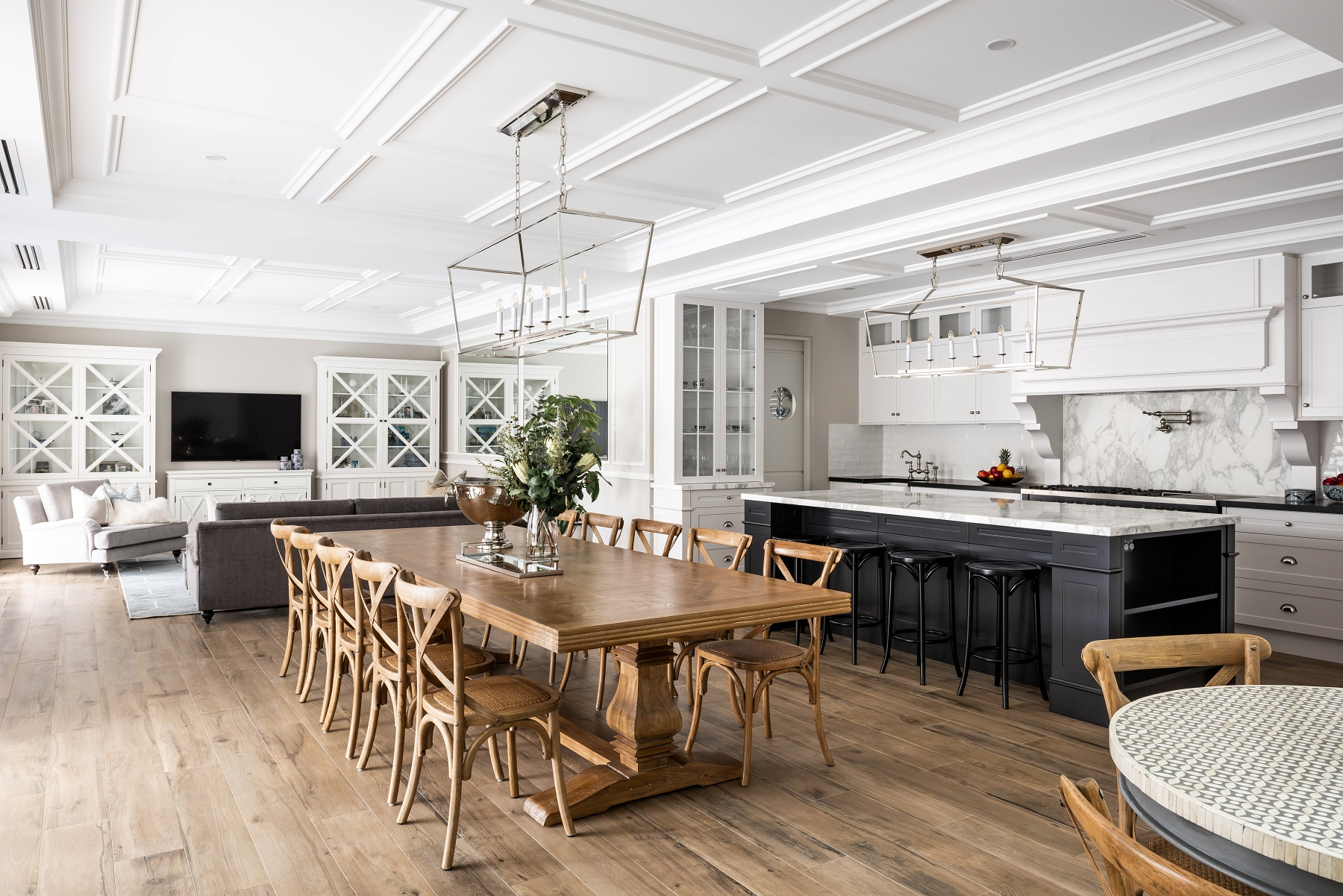 dining and kitchen space with timber flooring